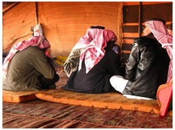 4999795-Bedouins_enjoying_tea_coffee_Wadi_Rum