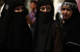 Iraqi female students wearing Arab folkl